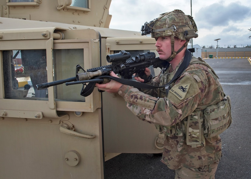 Sgt. Thomas Stewart, 1-35th Armored Regiment, establishes a security position during an Active Shooter exercise at the Joint Training Center in Jordan, Dec. 16, 2020. The purpose of the exercise was to validate the readiness of the JTC emergency response staff, and test how they respond to an active shooter event on post with multiple injuries and mass casualties, known as a MASCAL. (U.S. Army photo by Staff Sgt. Mark Scovell)