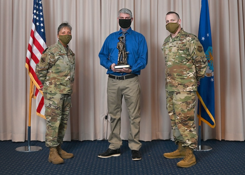 Col. Katrina Stephens, 66th Air Base Group commander, and Chief Master Sgt. Bill Hebb, 66 ABG command chief, present Scott E. Sheehan, 66th Civil Engineer Division, with the 2020 Civilian Category 2 of the Year award at Hanscom Air Force Base, Mass., Jan 20.