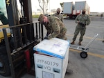 US troop opens package of COVID19 shipment