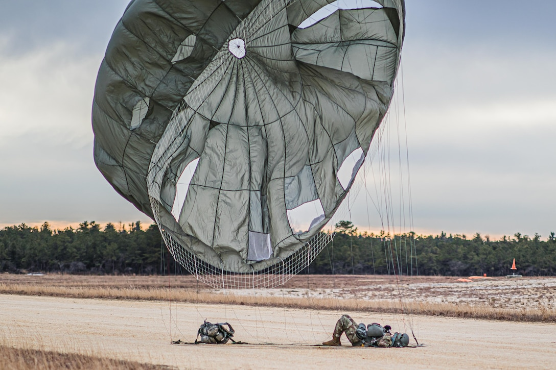 A U.S. Army Reserve Paratrooper comes to a safe landing during an airborne operation conducted by the 404th Civil Affairs Battalion and the 450th Civil Affairs Battalion, U.S. Army Civil Affairs & Psychological Operations Command (Airborne) at Joint Base McGuire-Dix-Lakehurst, N.J., Jan. 8, 2021. The unit conducted non-tactical airborne operations in order to maintain mission readiness and proficiency among their paratroopers.