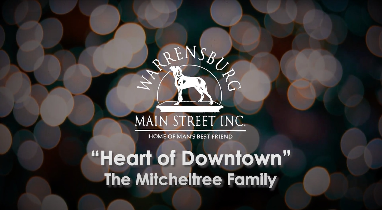 """The Mitchelltrees, an Air Force family assigned to Whiteman Air Force Base, Mo., earned the Warrensburg Main Street """"Heart of Downtown"""" award for their volunteer contributions to the Warrensburg Community. The award was revealed during the virtual """"Evening of Excellence"""" Jan. 14, 2021. (Courtesy Graphic by Warrensburg Main Street Inc.)"""