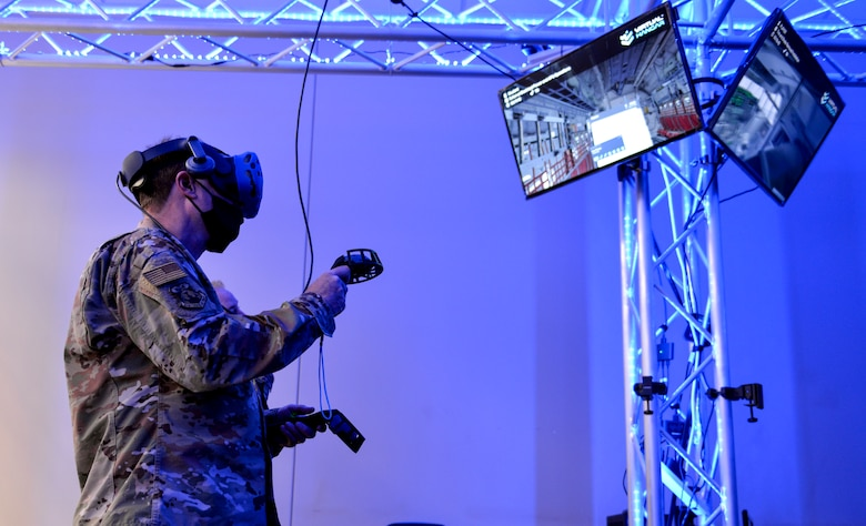 A person utilizes a VR training station