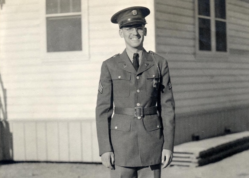 Soldier standing in front of building