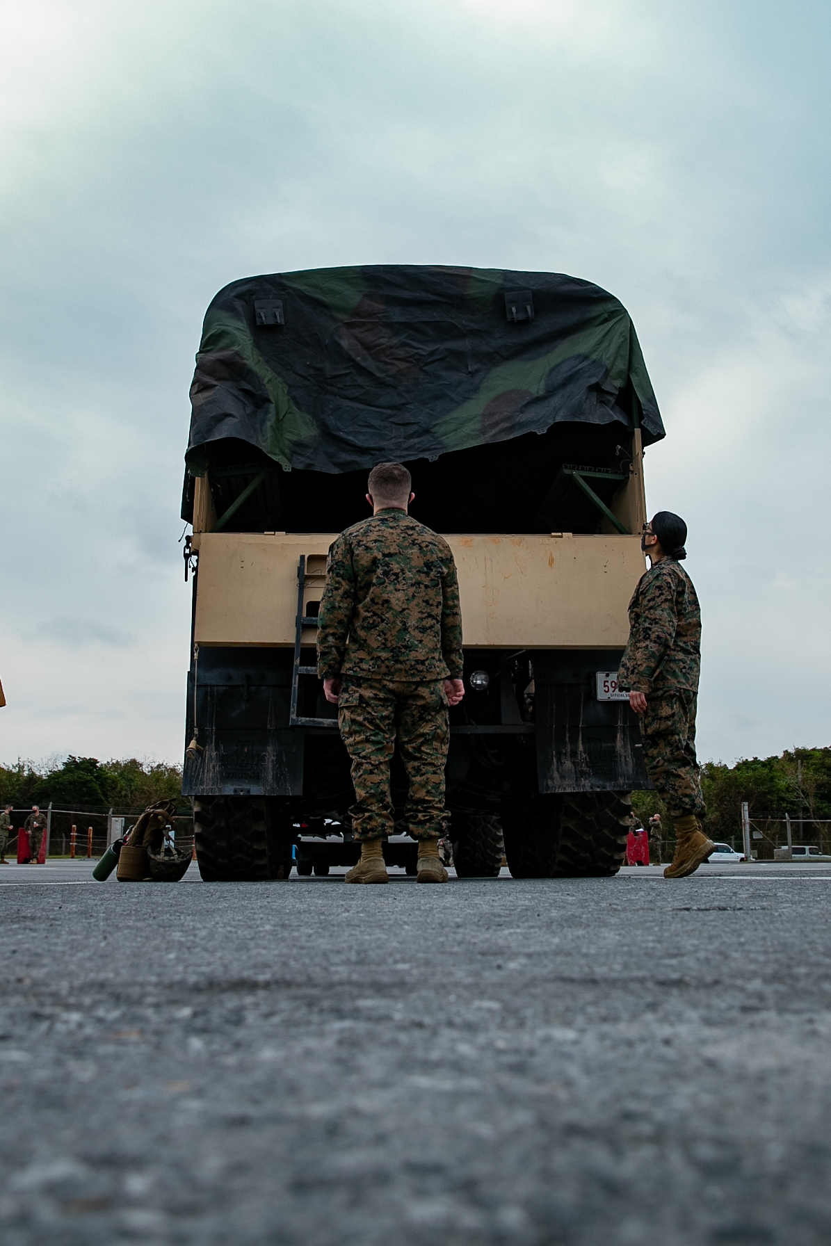 U.S. Marines with 3rd Landing Support Battalion, 3rd Marine Logistics Group, palletize gear in preparation for 3rd Marine Expeditionary Brigade's (MEB) deployment on Kadena Air Force Base, Okinawa, Japan, Jan. 21, 2021. 3rd MEB practices distributed operations as part of the Marine Corps' only forward-deployed force. (U.S. Marine Corps photo by Lance Cpl. Natalie Greenwood)