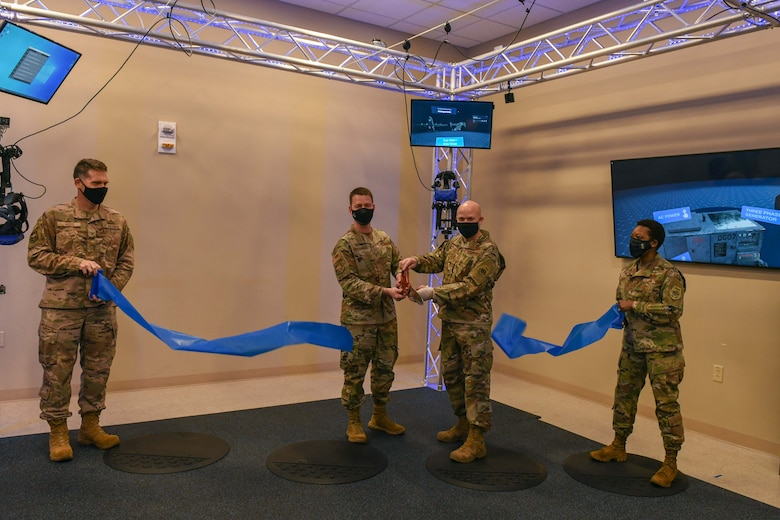 A grand-opening ribbon is cut