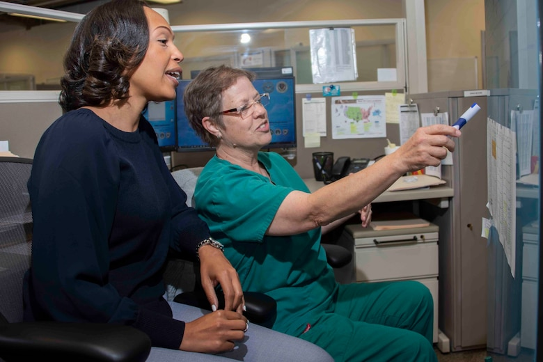 Zekelia Rembert and Anna Moore, virtual health nurse care coordinators, coordinate virtual health projects and outline participating Military Treatment Facilities at the Virtual Medical Center at Joint Base San Antonio-Fort Sam Houston May 16, 2019.