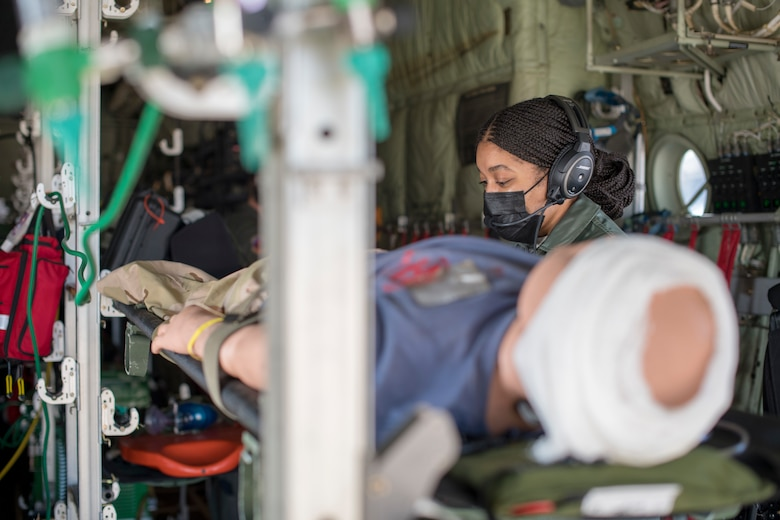Capt. Toya Williams, 36th Aeromedical Evacuation flight nurse, tends to a patient as part of her pre-deployment training at Keesler Air Force Base, Miss., Jan. 13, 2021. Williams will deploy to Ramstein Air Base, Germany where she will be a part of the 10th Expeditionary Aeromedical Evacuation Flight. (U.S. Air Force photo by Senior Airman Kristen Pittman)
