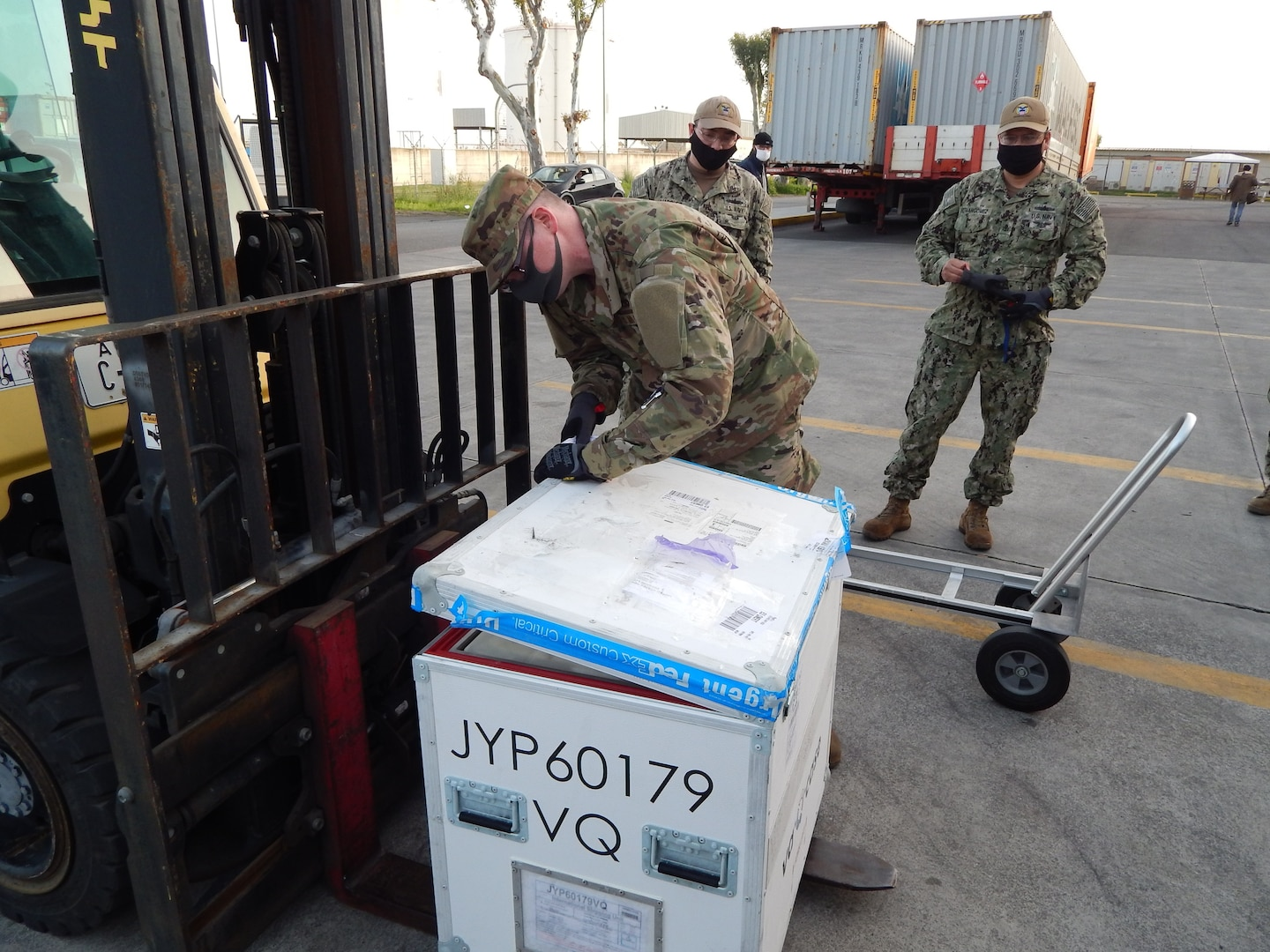 US Troop opens package of COVID-19 vaccine shipment