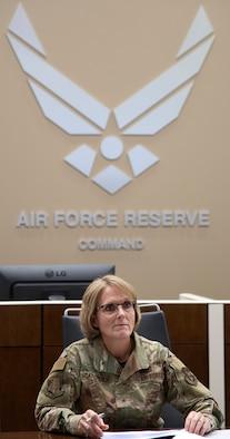 Brig. Gen. Stacey Scarisbrick, AFRC Force Generation Center commander, leads a Crisis Action Team meeting inside the FGC conference room in December