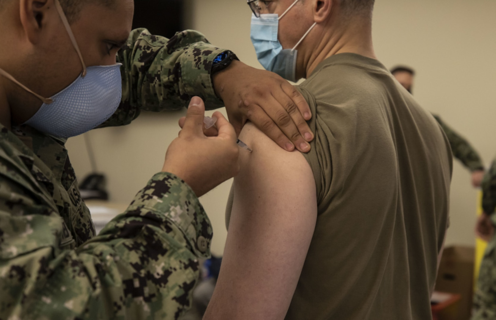 U.S. Army Lt. Col. Charles Calio, the public affairs officer deployed with Task Force 46, headquartered in Lansing, Mich., receives the Pfizer COVID-19 vaccine at the Navy Hospital at Camp Pendleton in Oceanside, California.