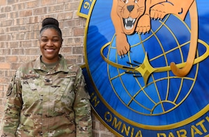 Lt. Col. Marshalria Vaughans, 97th Communications Squadron (CS) commander, stands next to the 97th CS logo on Jan. 20, 2020, at Altus Air Force Base, Oklahoma. Vaughans applied to transfer into the U.S. Space Force in May of 2020 and learned she'd been accepted in October of 2020. She is slated to become one of 150 cyber officers in the entire branch. (U.S. Air Force photo by Airman 1st Class Amanda Lovelace)
