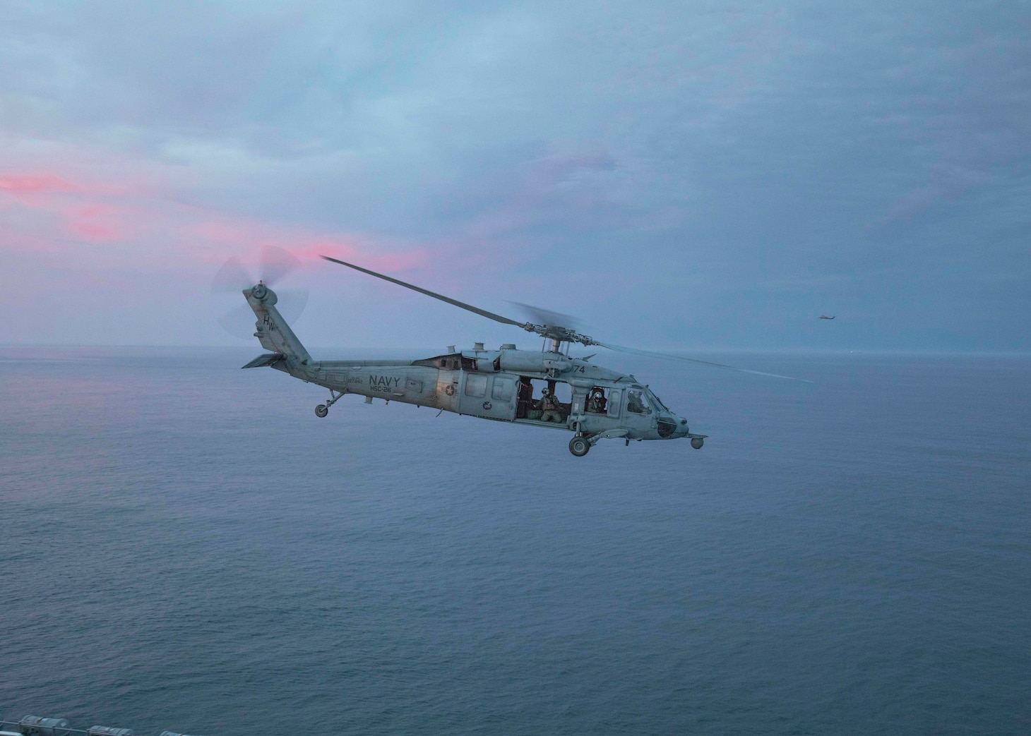 An MH-60S Sea Hawk, assigned to the Chargers, of Helicopter Sea Combat Squadron (HSC) 26, prepares to land on the flight deck aboard the amphibious assault ship USS Bataan (LHD 5).