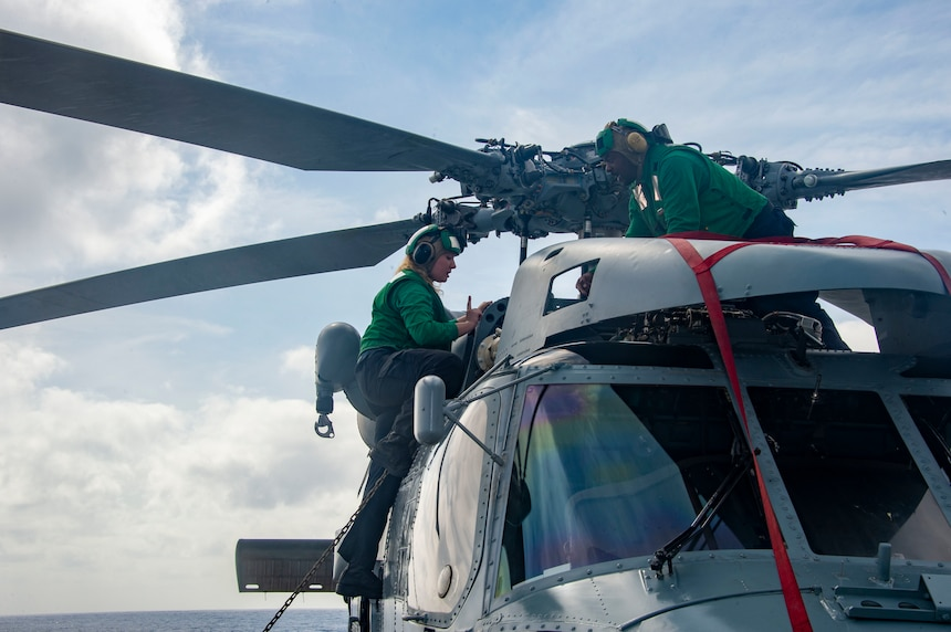 Sailors conduct pre-flight maintenance on an MH-60R Sea Hawk aboard the Arleigh Burke-class guided-missile destroyer USS James E. Williams (DDG 95).