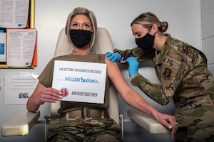 Airman receiving COVID-19 vaccination.