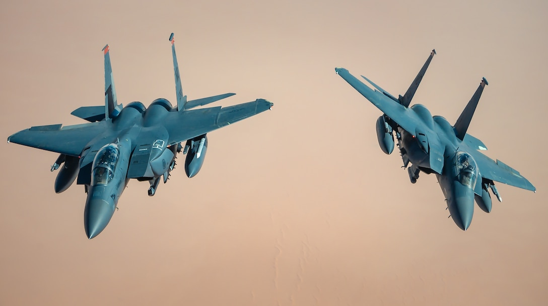 KC-135 provides fuel to F-15s