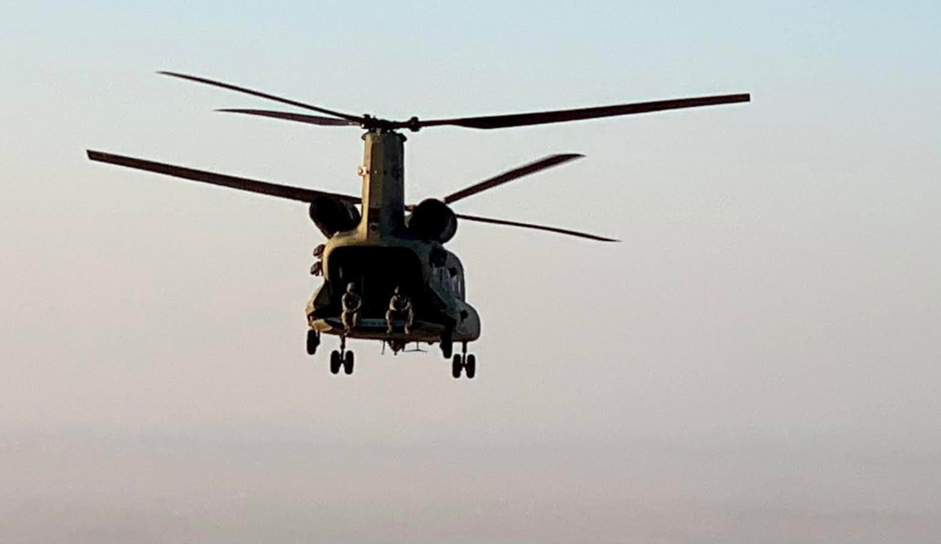 A CH-47 Chinook helicopter, operated by Soldiers with Bravo Company, 3-238th General Support Aviation Battalion, 28th Expeditionary Combat Aviation Brigade, flies over the 28th ECAB's area of operations in the Middle East during a routine flight mission. Soldiers with the 28th ECAB recently passed the midway point of their deployment.