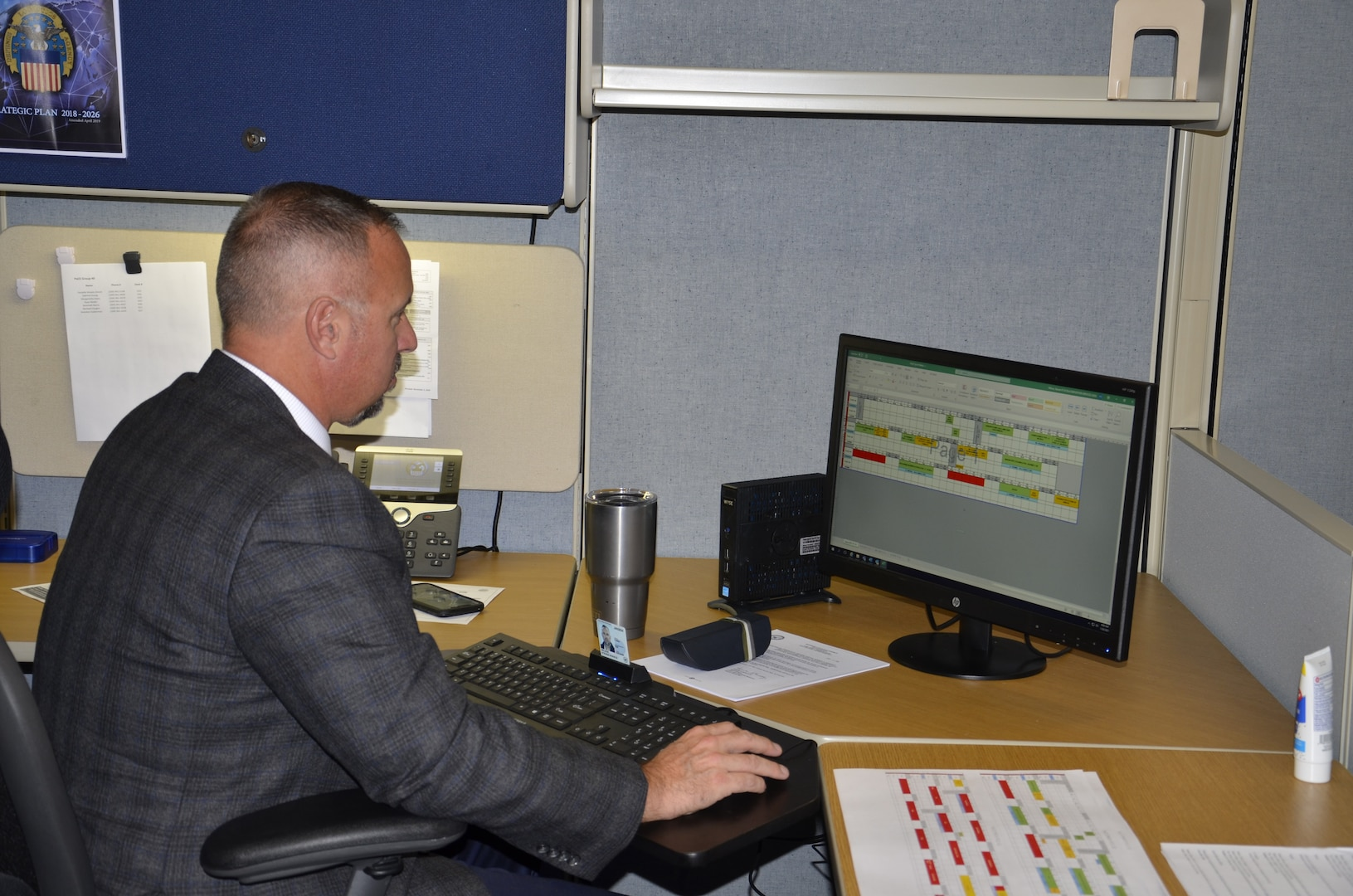 Steve Wilson, the new Pathways to Career Excellence Program manager for DLA Disposition Services, studies a training plan to help guide participants in their development