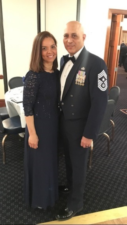 Chief Master Sgt. Jose Velez, Jr., former 459th Air Refueling Wing Command Chief, poses for a photo with his wife Ivelisse, during an awards banquet January 2019. Velez will complete 26 years of military service on Feb. 28, 2021. (Courtesy Photo)