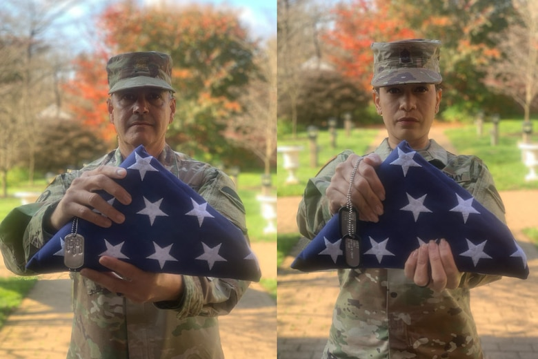Retired Soldiers Alvin and Yara Lopez display their retirement flags.