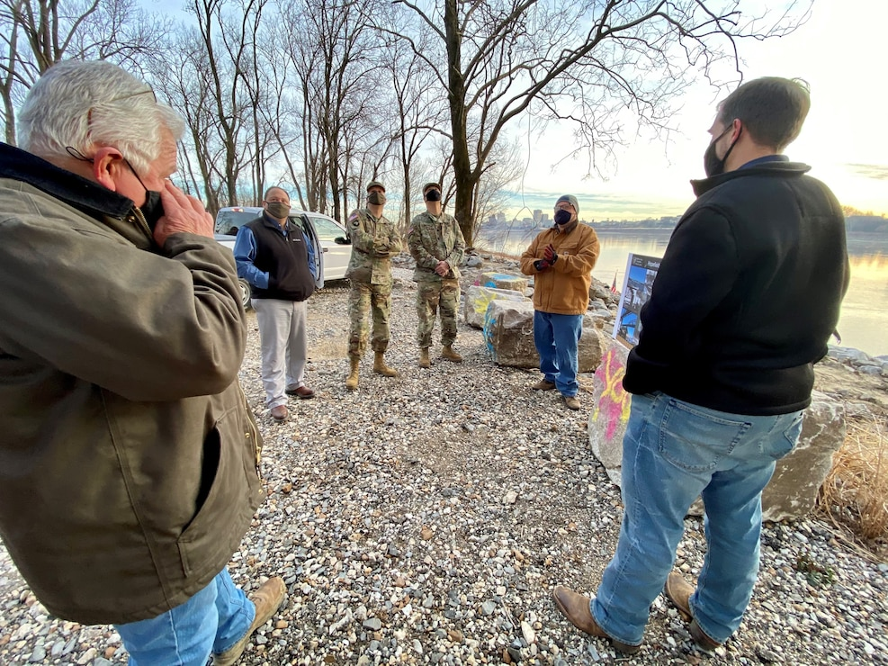 IN THE PHOTOS, Project Manager Mark Mazzone briefs Memphis District Commander Col. Zachary Miller and other district leadership on the details of the Hopefield project at the exact site where the armoring took place. Afterward, the group walked down to the riverbank to cut the ribbon, symbolizing the victory and celebration of completing yet another significant project. (USACE photos by Jessica Haas)