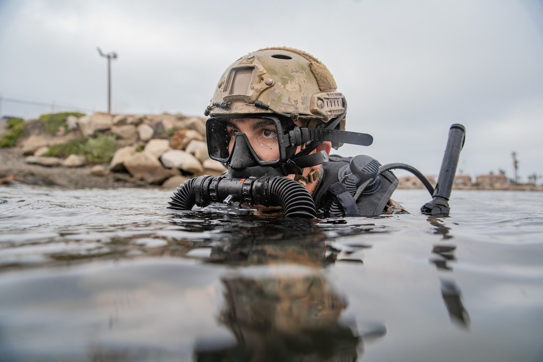 U.S. Marine Corps Cpl. Andre Gordon, a radio telephone operator with the All Domain Reconnaissance Detachment (ADRD), 11th Marine Expeditionary Unit (MEU), prepares to dive during a combatant dive exercise at Marine Corps Base Camp Pendleton, California, Jan. 5, 2020. The ADRD conducted the training to refine and sustain proficiency in combatant dive skills and enhance the capability to conduct specialized insertion and extraction methods in preparation for their upcoming deployment with the 11th MEU. (U.S. Marine Corps photo by Sgt. Jennessa Davey)