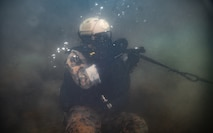 U.S. Marine Corps Cpl. Ryan Williams, a reconnaissance team pointman with the All Domain Reconnaissance Detachment (ADRD), 11th Marine Expeditionary Unit (MEU), practices dive operations during a dive combatant exercise at Marine Corps Base Camp Pendleton, California, Jan. 5, 2020. The ADRD conducted the training to refine and sustain proficiency in combatant dive skills and enhance the capability to conduct specialized insertion and extraction methods in preparation for their upcoming deployment with the 11th MEU. (U.S. Marine Corps photo by Sgt. Jennessa Davey)