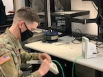 Pfc. Patrick Cross, biomedical electronics technician for Medical Department Activity – Alaska fixes a leak in a pneumatic tourniquet from the physical therapy department. Cross is part of a team that works to ensure medical equipment functions properly for safe patient care
