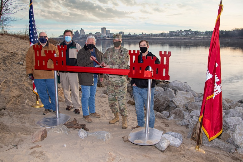 IN THE PHOTO, Project Delivery Team members and Memphis District Commander Col. Zachary Miller cut the ribbon at the Hopefield construction site, symbolizing the victory and celebration of completing yet another significant project. (USACE photo by Vance Harris)