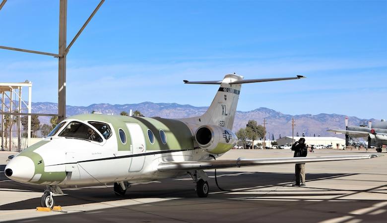 Chad Ellingson, 576th Aerospace Maintenance and Regeneration Squadron, assists the flight crew.