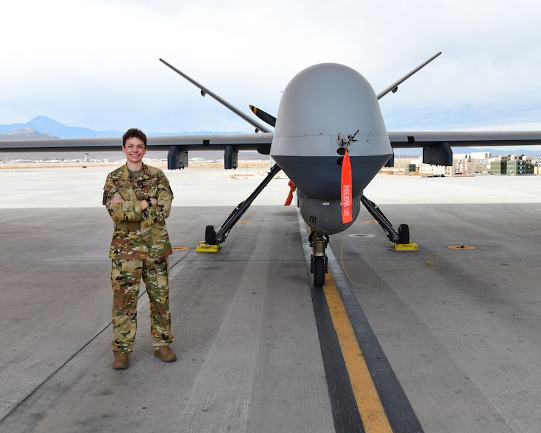Master Sgt. Brittany, 91st Attack Squadron first sergeant, stands in front of MQ-9 Reaper, Jan. 22, Creech Air Force Base, Nevada. Brittany is one of the first enlisted aviators who have taken the step outside her career field to become a first sergeant, while still maintaining her flight hours and required qualifications.