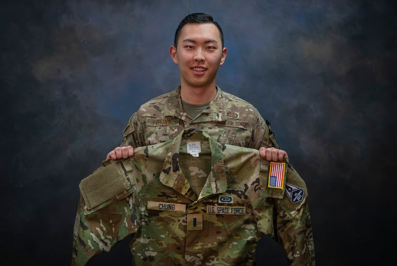1st Lt. Issac Chung, 97th Operations Support Squadron officer in charge of intelligence operations, shows his uniform with U.S. Space Force (USSF) name tapes on Jan. 13, 2020, at Altus Air Force Base, Oklahoma. Chung applied to transfer into the USSF in May of 2020 and learned he'd been accepted in October of 2020. He is slated to swear in to the USSF on Feb. 4, 2021. (U.S. Air Force photo by Airman 1st Class Amanda Lovelace)