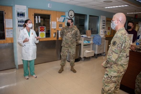 Army Lt. Gen. Ronald Place, Director, Defense Health Agency, talks with Army Lt. Col. Elizabeth Markelz, Infectious Disease Staff Physician, and Army Lt. Col. Robert Walter, Chief of Pulmonary and Critical Care Medicine, at Brooke Army Medical Center, Fort Sam Houston, Texas, Jan. 20, 2021.