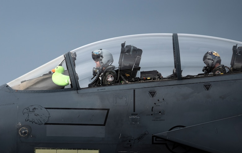 U.S. Air Force Capt. Andrew Munoz, former 494th Fighter Squadron F-15E Strike Eagle pilot and now 335th Fighter Squadron chief of plans, taxis down the runway with Scoff the Duck after returning from his final flight at Royal Air Force Lakenheath, England, Oct. 28, 2020. Many pilots have  flown with special mementos and gifts from loved ones, which serve as a mental boost of assurance, or a little piece of home when they are away. (U.S. Air Force photo by Airman 1st Class Jessi Monte)