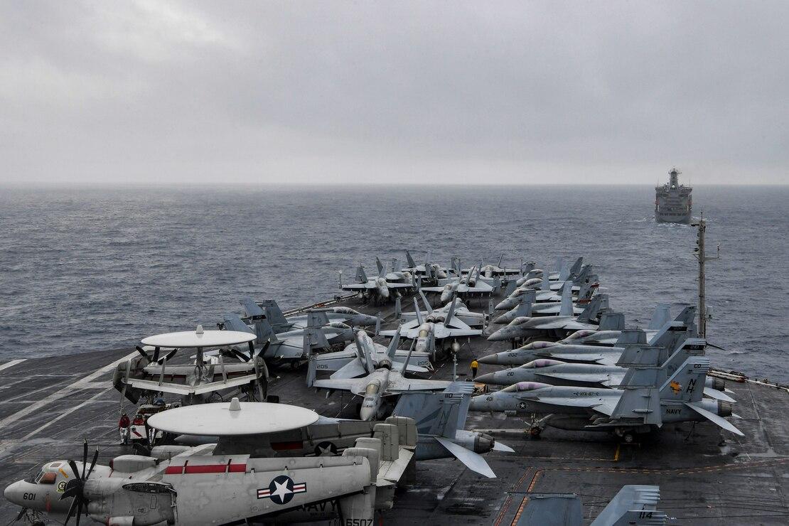 The aircraft carrier USS Theodore Roosevelt (CVN 71) approaches the fleet replenishment oiler USNS John Ericsson (T-AO 194) during a replenishment-at-sea Jan. 22, 2021.