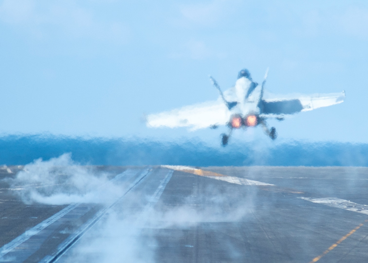 """PACIFIC OCEAN (Jan. 23, 2021) – An F/A-18F Super Hornet, assigned to the """"Black Knights"""" of Strike Fighter Squadron (VFA) 154, takes off from the flight deck of the aircraft carrier USS Theodore Roosevelt (CVN 71) Jan. 23, 2021. The Theodore Roosevelt Carrier Strike Group is on a scheduled deployment to the U.S. 7th Fleet area of operations. As the U.S. Navy's largest forward deployed fleet, with its approximate 50-70 ships and submarines, 140 aircraft, and 20,000 Sailors in the area of operations at any given time, 7th Fleet conducts forward-deployed naval operations in support of U.S. national interests throughout a free and open Indo-Pacific area of operations to foster maritime security, promote stability, and prevent conflict alongside 35 other maritime nations and partners."""