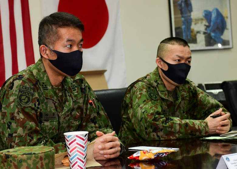 Japanese soldiers listen to briefing about U.S. Air Force reconnaissance procedures.