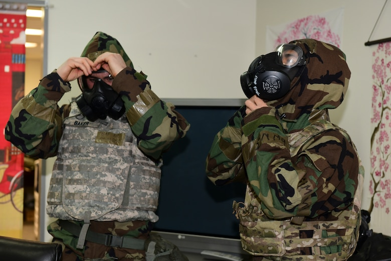 American Airman show how to properly put on protective gear.