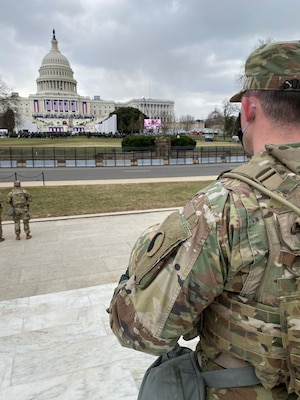 A Virginia National Guard Soldier assigned to Alpha Company, 229th Brigade Engineer Battalion, 116th Infantry Brigade Combat Team, stands guard at the Capitol during the 59th presidential inauguration Jan. 20, 2021, in Washington. About 1,000 Virginia Guard members are remaining in the nation's capital to assist local and federal authorities.