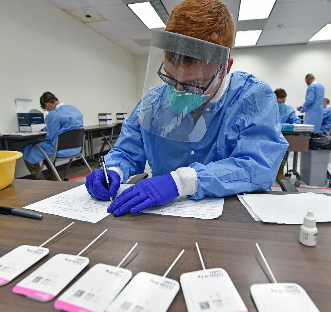 Pfc. Jagher Jones with Company A, 232nd Medical Battalion, testing COVID-19 antigen samples.