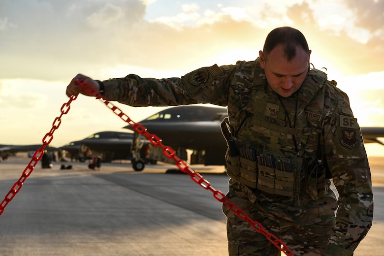 U.S. Air Force Staff Sgt. William Deitt, 509th Security Forces Squadron combat arms instructor, sets up a cordon during Red Flag 21-1, at Nellis Air Force Base, Nevada, Jan. 22, 2021. Along with aircrew, Team Whiteman brought approximately 100 Airmen to participate in the large force exercise and to be the lead wing. As the lead Wing, RF 21-1 enables Team Whiteman to maintain a high state of readiness and proficiency, while validating our always-ready global strike capability. (U.S. Air Force photo by Staff Sgt. Sadie Colbert)