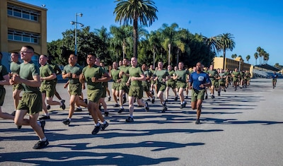 You voted, and we listened! Here's this weeks top shot winner!  New Marines with Lima Company, 3rd Recruit Training Battalion, participate in a motivational run at Marine Corps Recruit Depot, San Diego, Jan. 21, 2021. Following graduation on Jan. 22, the new Marines will be transported to Camp Pendleton, Calif., to begin their next phase of training. (U.S. Marine Corps photo by Lance Cpl. Grace J. Kindred)