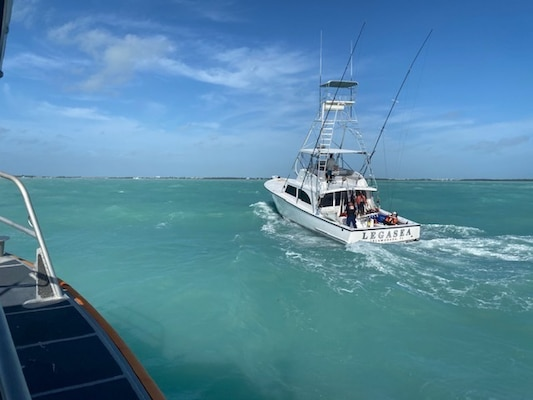 A Coast Guard Station Islamorada 45-foot response boat-medium boat crew assisted three people aboard a 50-foot white sport fisher vessel, Legasea, taking on water, Saturday, approximately 5 miles south of Tavernier, Jan. 2, 2020. The crew used a dewatering pump to remove the water, identify the source of flooding, and escorted the vessel to the Postcard Inn in Islamorada. (U.S. Coast Guard courtesy photo.)