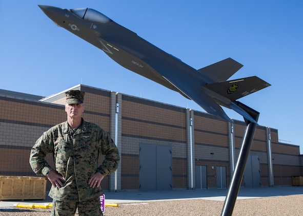 U.S. Marine Corps Maj. Gen. Christopher J. Mahoney, commanding general of 3rd Marine Aircraft Wing, stands in front of the new F-35 flight simulator on Marine Corps Air Station Miramar, Calif., Jan. 21, 2021.