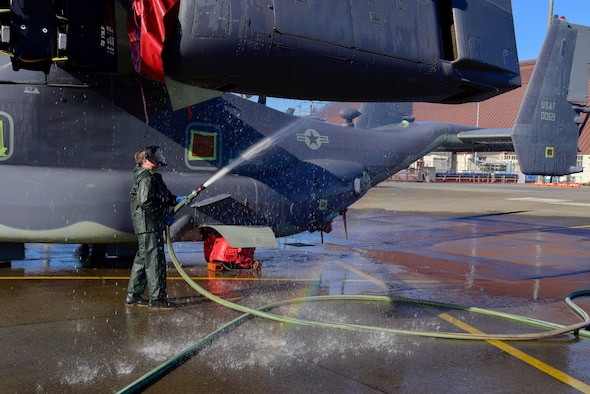 Senior Airman Brody Lee, 753rd Special Operations Aircraft Maintenance Squadron crew chief, cleans a wing of a CV-22 Osprey assigned to the 21st Special Operations Squadron at Yokota Air Base