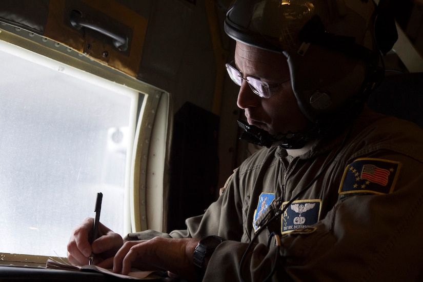 U.S. Air Force Tech. Sgt. Eric Dickerson, a loadmaster assigned to the 211th Rescue Squadron, Alaska Air National Guard, creates a timeline for a HC-130J Combat King II's simulated search and rescue over Alaska, Jan. 21, 2021, during Operation Noble Defender. Operation Noble Defender is a North American Air Defense Command air-defense operation which allows dynamic training for operational readiness in an arctic environment.