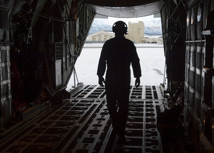 U.S. Air Force Tech. Sgt. Eric Dickerson, a loadmaster assigned to the 211th Rescue Squadron, Alaska Air National Guard, conducts a preflight check on a HC-130J Combat King II at Joint Base Elmendorf-Richardson, Alaska, Jan. 21, 2021, during Operation Noble Defender. Operation Noble Defender is a North American Aerospace Defense Command air-defense operation which allows dynamic training for operational readiness in an arctic environment.