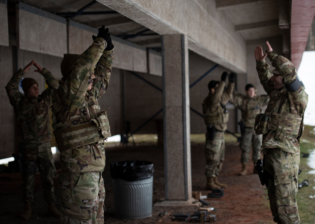 U.S. Air Force Airmen assigned to the 569th U.S. Forces Police Squadron perform unit exercises at Breitenwald Landstuhl Range, Germany, Jan. 20, 2021.