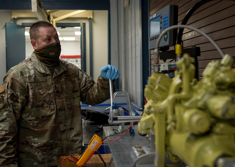 Staff Sgt. Steven Hall, 4th Component Maintenance Squadron centralized repair facility expeditor, tests a stabilator actuator at Seymour Johnson Air Force Base, North Carolina, Jan. 7, 2021.