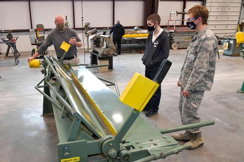 (Left to right) Darrel Gronau, aviation structure repair instructor, teaches metal forming and tool safety to Isaac Jensen and Connor Innocenzi, both Utah Military Academy students.