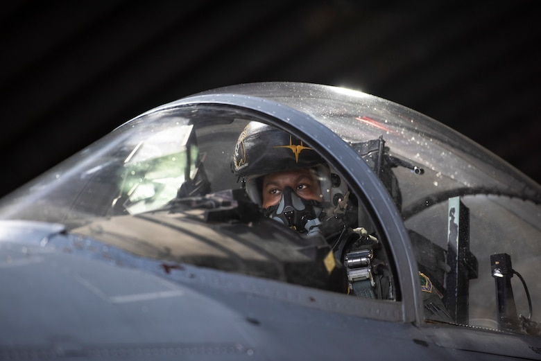 U.S. Air Force Capt. Joshua Jones, 493rd Fighter Squadron F-15C Eagle pilot, conducts pre-flight checks at Royal Air Force Lakenheath, England, Jan. 21, 2021. Aircrew and other Airmen and Aircrew from non-maintenance career fields recently had the opportunity to practice Agile Combat Employment concepts while helping generate sorties for the 493rd FS. (U.S. Air Force photo by Airman 1st Class Jessi Monte)